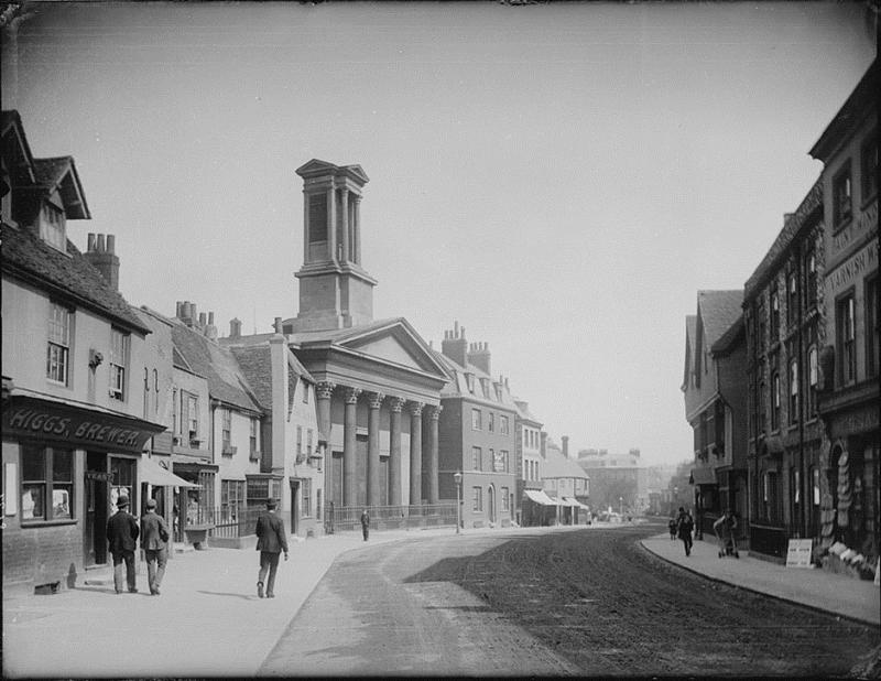 1890 Castle Street showing building on north side and the distinctive 'pepper-box' on church tower, all now removed (Castle Street, Reading, looking eastwards, 1890. On the north side, No. 20 (S. H. Higgs, Lion Brewery); No. 14 (Sun Inn) and St. Mary's Ep