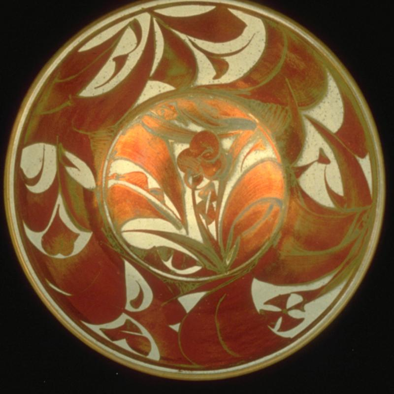 A red bowl designed by Alan Caiger-Smith.