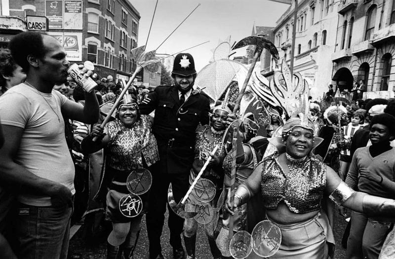 A policeman joining in with the festivities at the Notting Hill Carnival in west London. (Photo by Frank Barratt/Getty Images)
