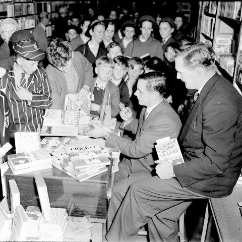 The interior of William Smith & Son October 1957.  The Reading born England cricket captain, Peter May with England cricketer Jim Laker signing copies of their books. (c) Reading Borough Council, Reading Museum