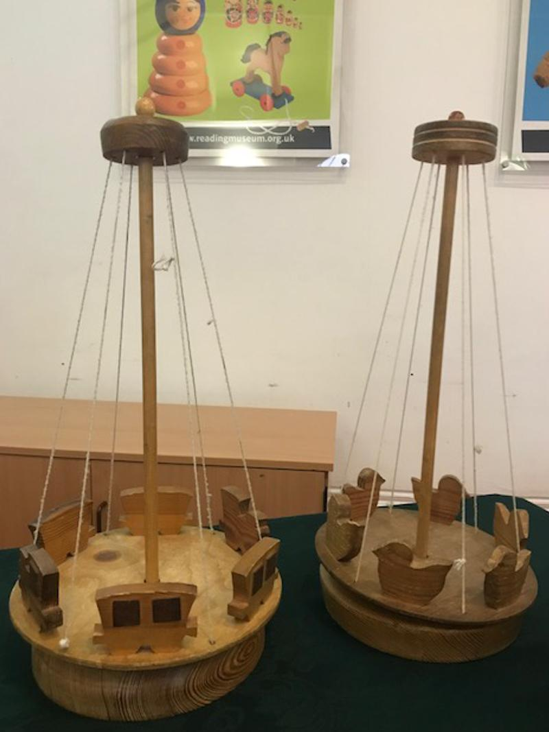 two wooden carousels