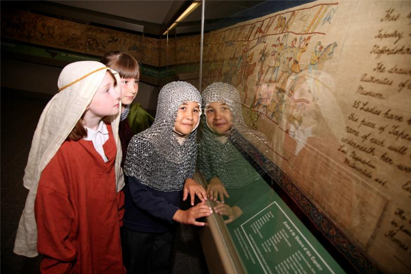 Children looking at the Bayeux Tapestry