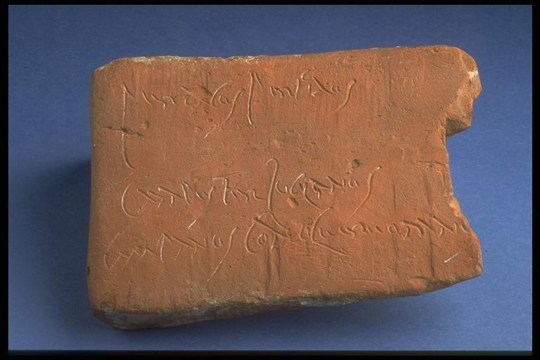 Graffito in cursive script on a box flue tile which ends with words from Virgil's Aeneid; thought to be a writing lesson, found at Silchester in 1850 (REDMG : 1995.1.26)