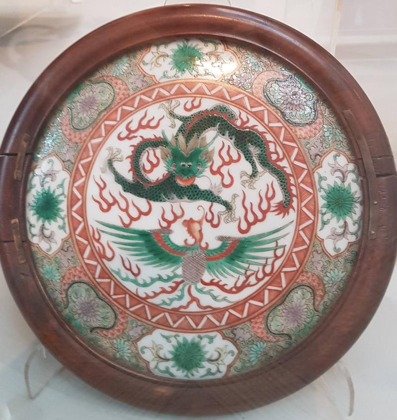 Chinese porcelain plaque depicts a dragon and phoenix