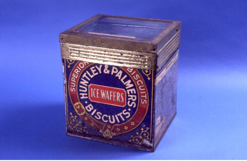an iced wafer Huntley and Palmers shop tin
