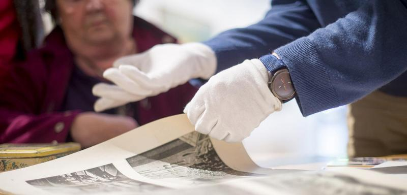 Image of museum staff handling an object.
