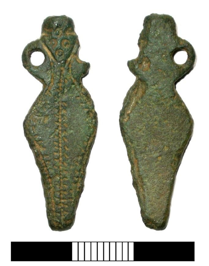 A late Roman strap end of amphora-shaped form. The strap end has two loop attachments, one of which is now missing.