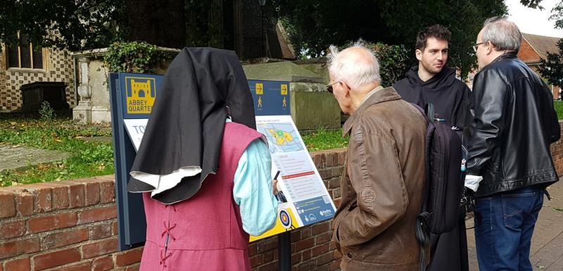 Staff and volunteers asking the public for comments about prototype abbey panel
