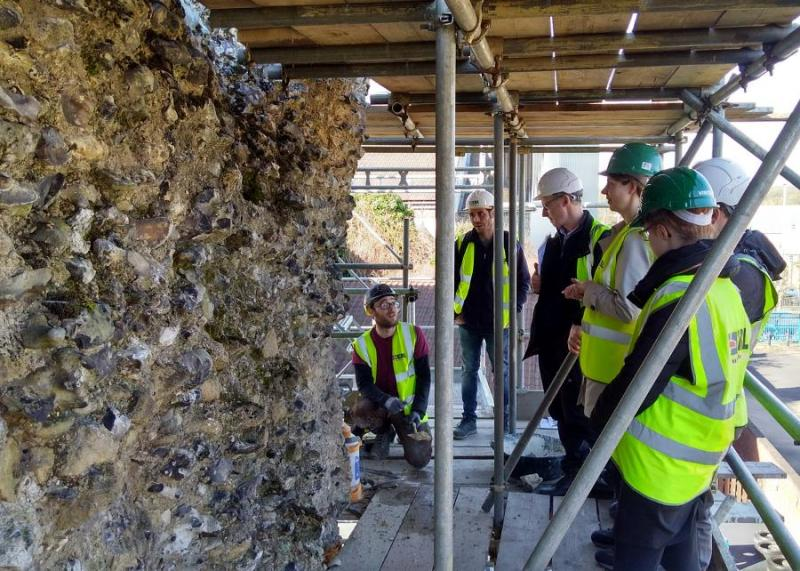 Staff look at conservation work at Reading Abbey.