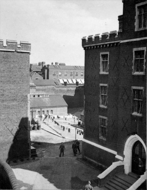 This photograph depicts the interior of the Reading Gaol courtyard in 1945.