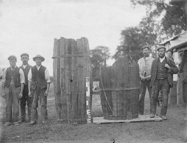 Group of excavators with two wooden barrels, Silchester. Photograph by F. Mason Good - 1897.