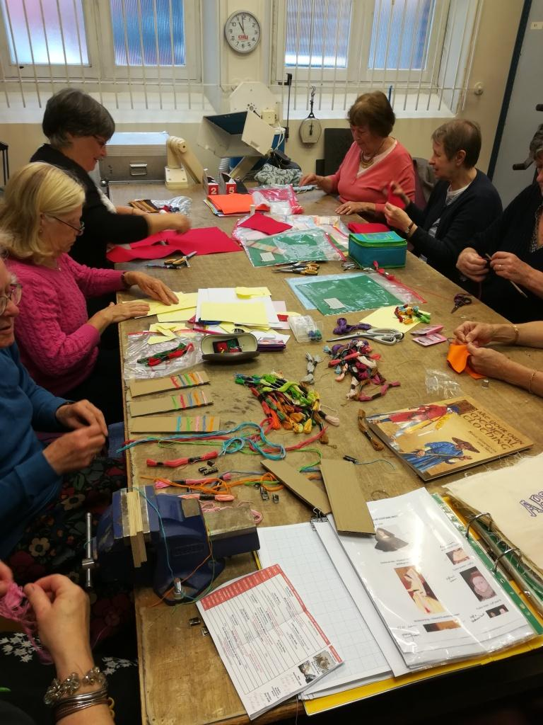 sewing volunteers and the abbey gateway panel