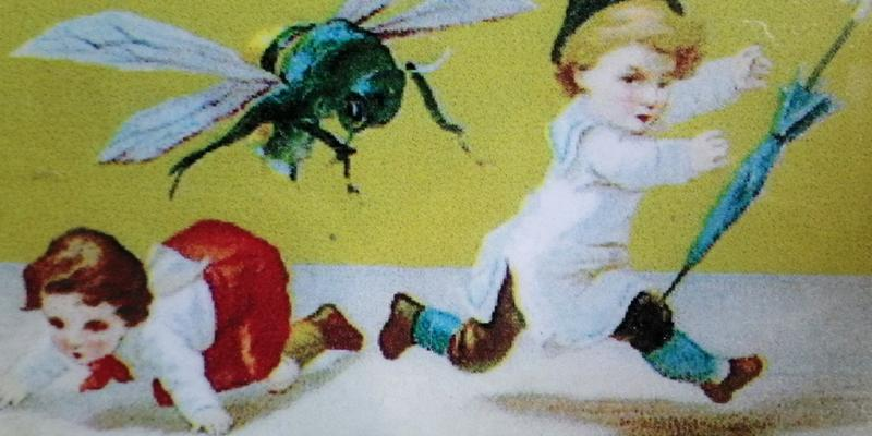 A Christmas card showing children being chased by an enormous fly.