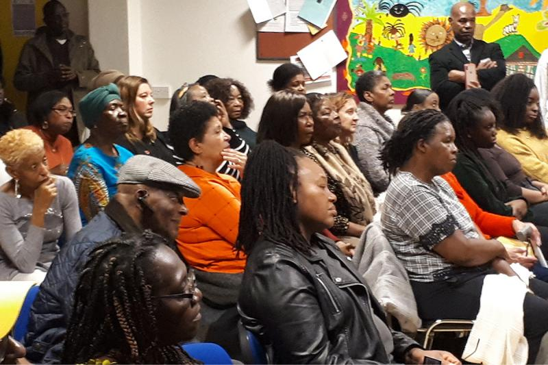 Spectators watch the Reading Windrush Day Project 2019's cultural event.