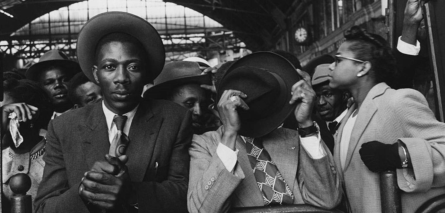West Indian Immigrants at Victoria Station Immigrants from the West Indies at Victoria Station in London, 1956. Published in Picture Post, 8405 Vol 71, 9 June 1956. (Photo by © Hulton-Deutsch Collection/CORBIS/Corbis via Getty Images)