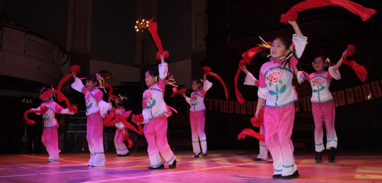 Children dancing in pink with streamers