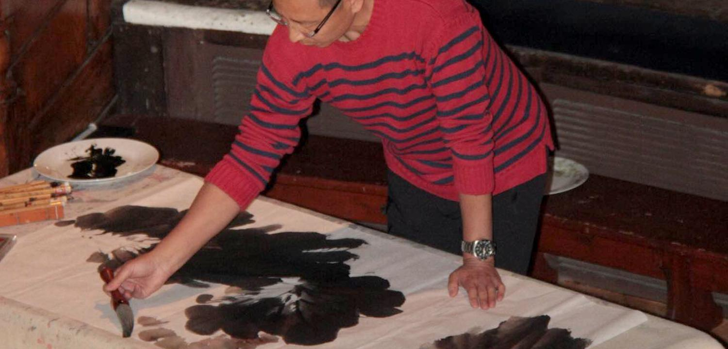 An artist making a painting on a table
