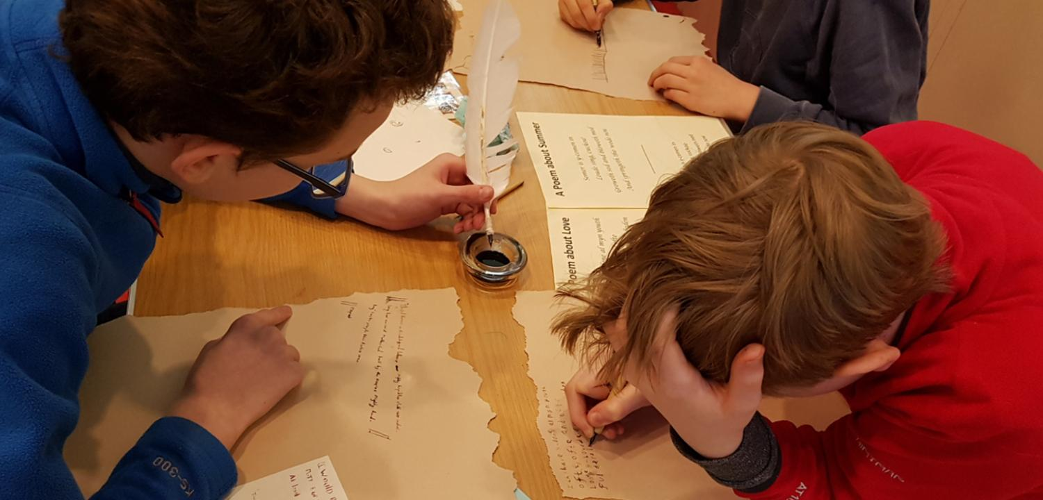 Children writing with quills