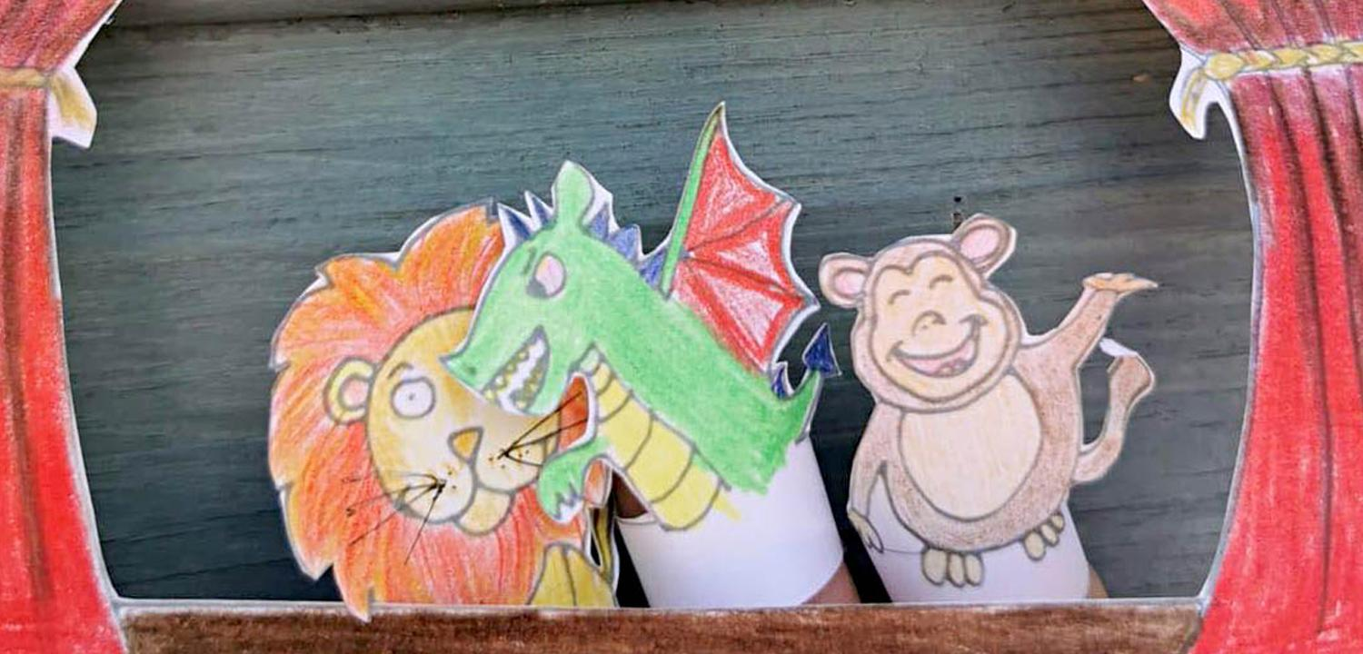 A photograph of a puppet theatre created by Reading Museum staff, as part of the new 'ANIMAL: World Art Journeys' activity cart.