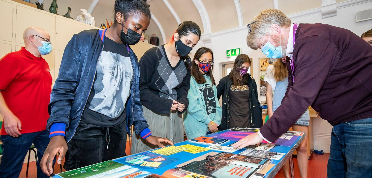 Young people looking at graphic marketing materials