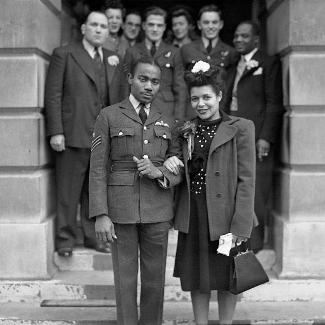 Wartime Wedding RAF sergeant Owen Sylvester of the West Indies, with Laureen Goodare of St Pancras, after their wedding at St Pancras Town Hall, London, 21st October 1944. (Photo by Reg Speller/Fox Photos/Hulton Archive/Getty Images)