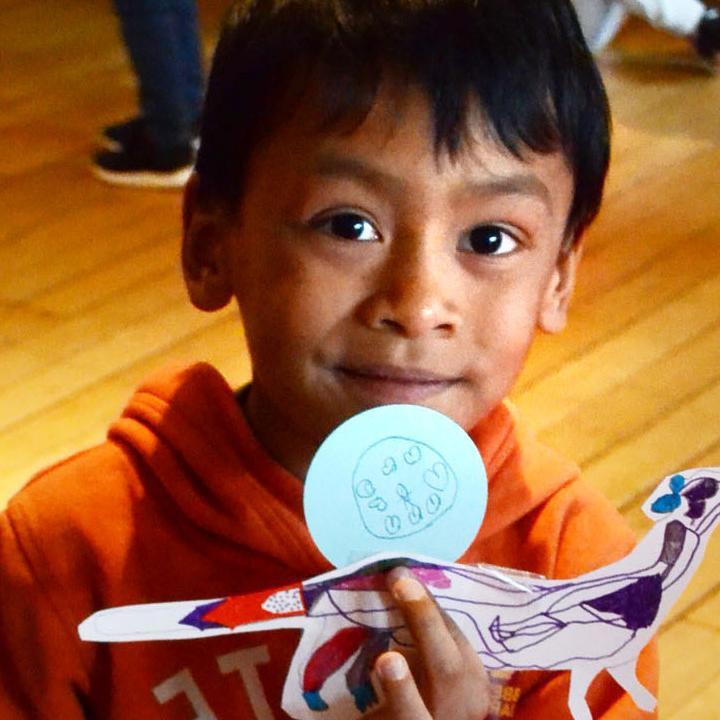 A boy holding a badge