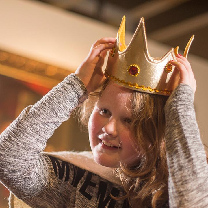 Child trying on a crown
