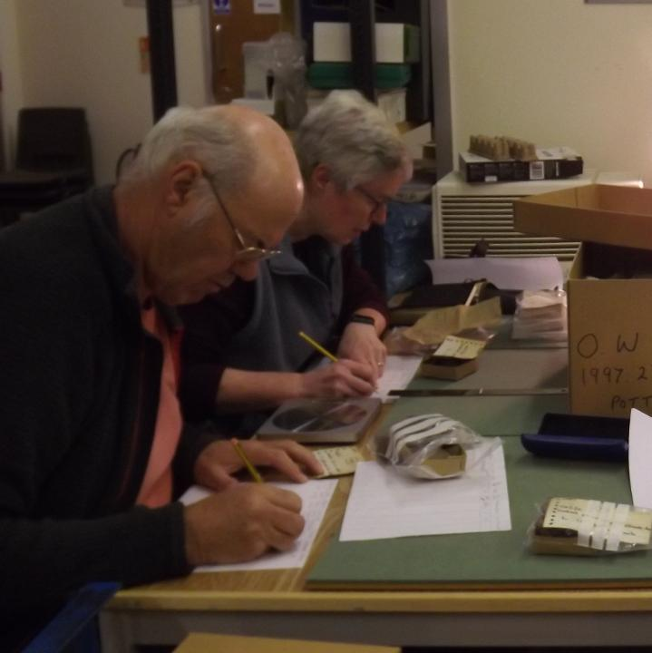four volunteers at a desk