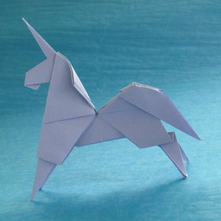 An origami unicorn on a blue background
