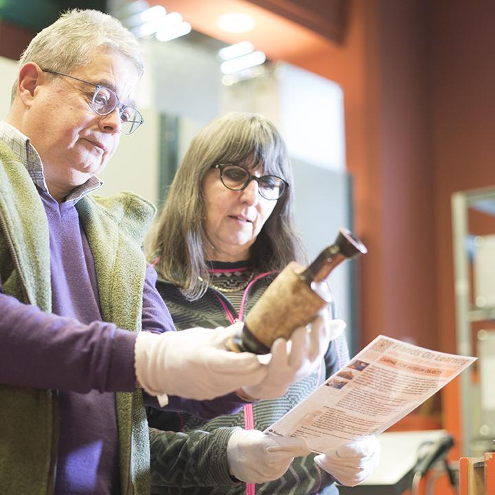Volunteers handling museum objects