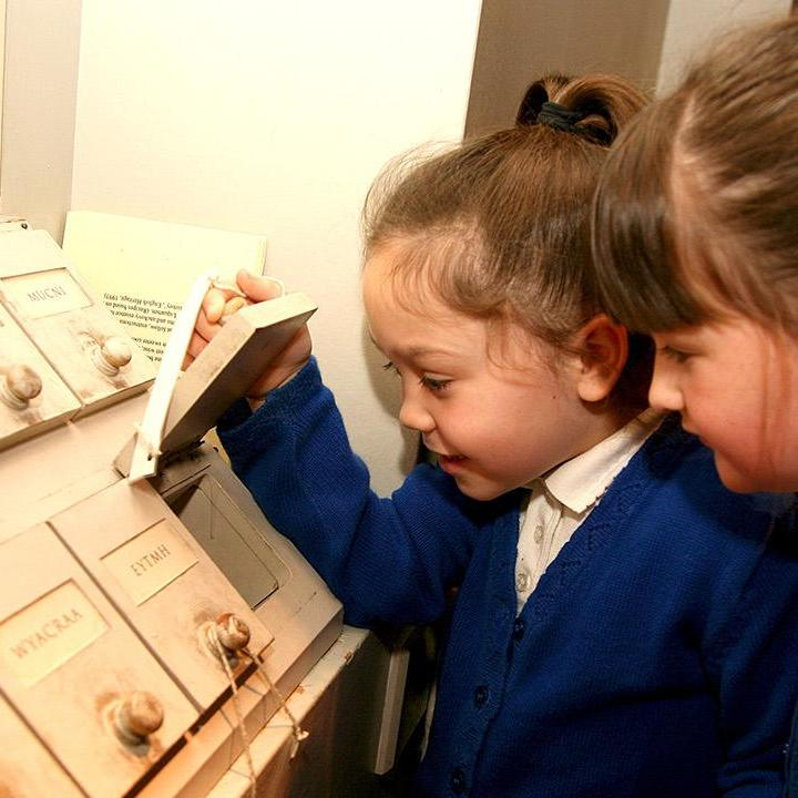 Children looking at a museum interactive display