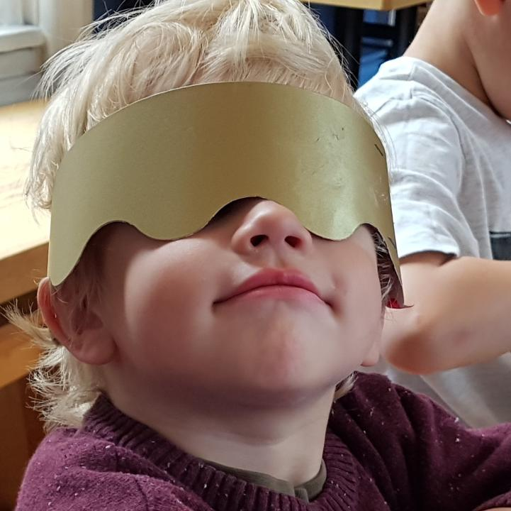 Boy wearing a handmade crown