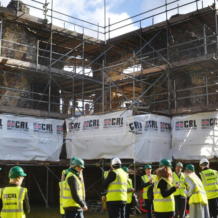 Visitors have a conservation tour of the Reading Abbey Ruins.