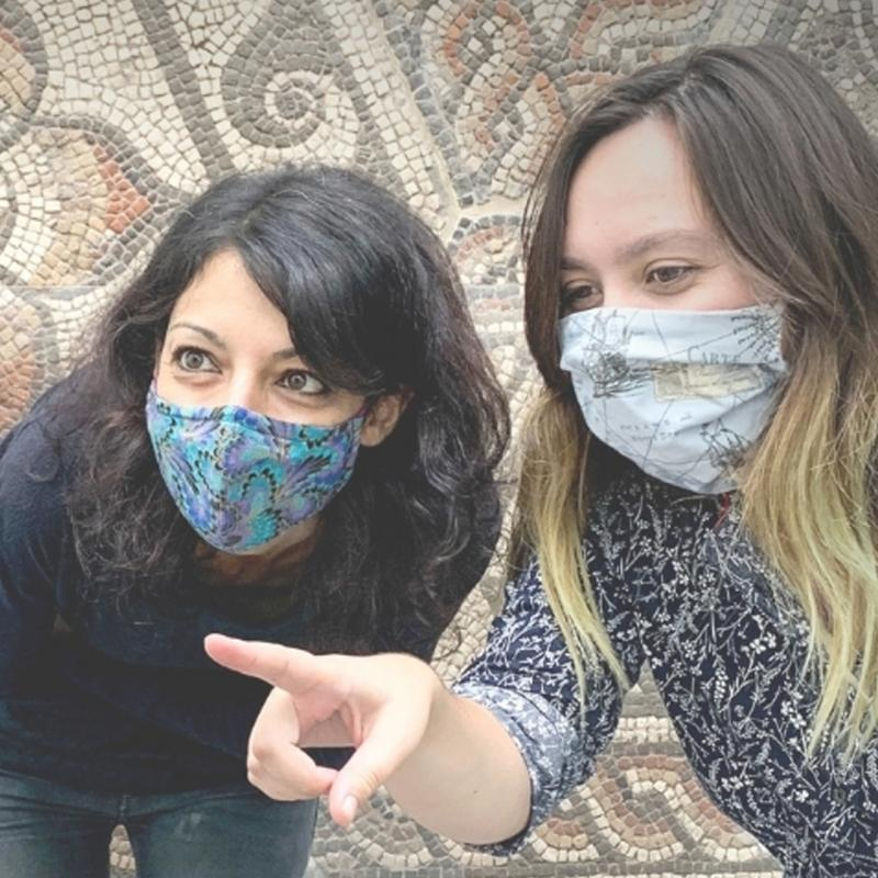 Two visitors wearing a mask.