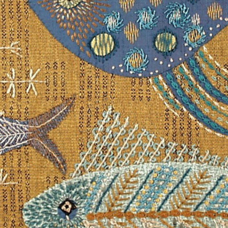 An embroidery of a blue fish