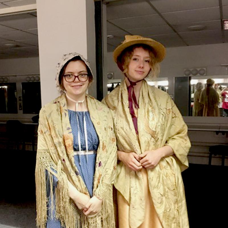 Costumed interpreters pose for a picture