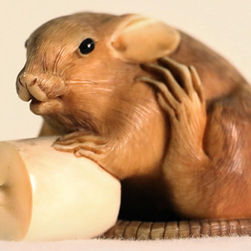 A Japanese netsuke, a small mouse figurine.