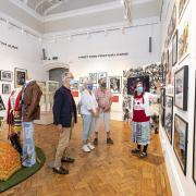 Visitor enjoying the 1971 Reading Festival exhibition in the Art Gallery