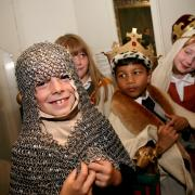 Children enjoying dressing up in the Bayeux Tapestry gallery