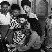 Social Gathering; West Indian women singing around a piano, 2nd July 1949 (Photo by Bert Hardy/Picture Post/Hulton Archive/Getty Images)