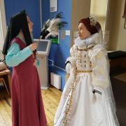 Tudor woman and Queen Elizabeth I interaction