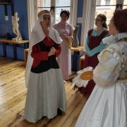Costumed interpreter volunteers rehearsal